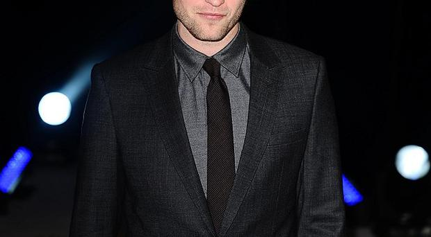 Robert Pattinson needed a wig to recreate his floppy-haired look for Twilight re-shoots