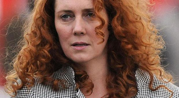 Cleaners were warned last June to avoid disturbing 'listening devices' hidden in Rebekah Brooks's office, a book claims