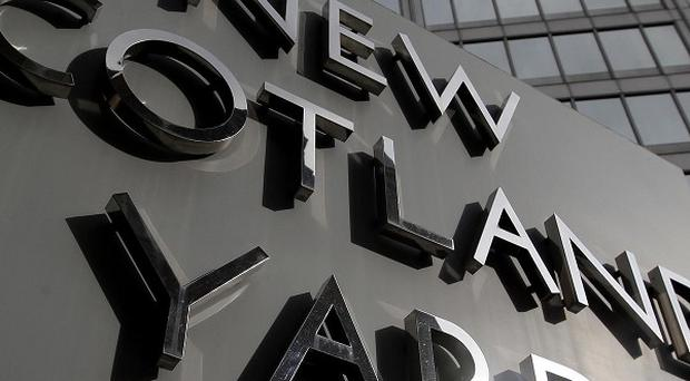 Detectives involved in Scotland Yard's Operation Elveden arrested The Sun's royal editor