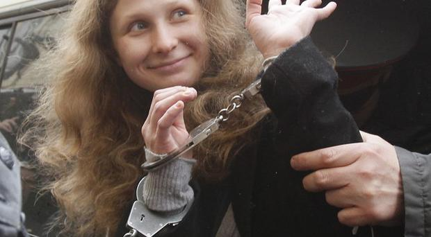 Punk rocker Maria Alekhina of Pussy Riot is escorted to a courtroom in Moscow(AP)