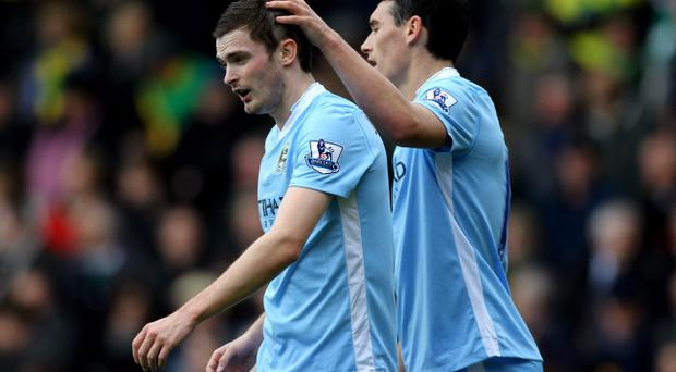 Adam Johnson (left) responded to criticism from Manchester City manager Roberto Mancini
