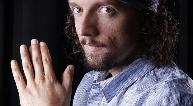 Jason Mraz says there is a darker side to his music