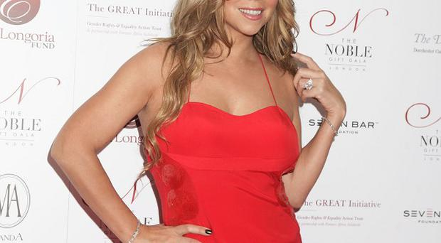 Mariah Carey said she has to work hard to keep her figure these days
