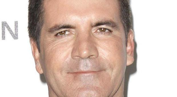 A biography of Simon Cowell suggests ITV 'lacks respect' for the media mogul