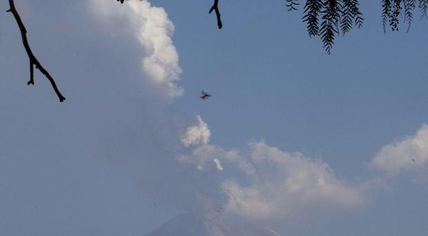 A plume of ash and steam rises from Popocatepetl volcano in Mexico (AP)