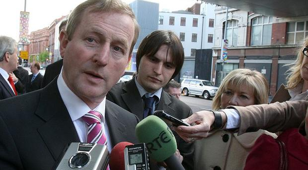 Taoiseach Enda Kenny arrives at the Belfast campus of the University of Ulster