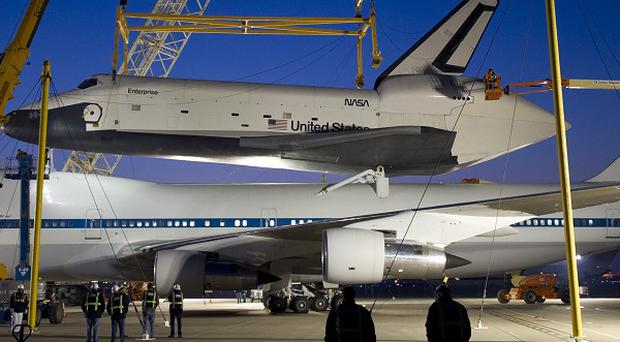 The space shuttle Enterprise rests on the 747 Shuttle Carrier Aircraft at Washington Dulles International Airport (AP/Nasa)