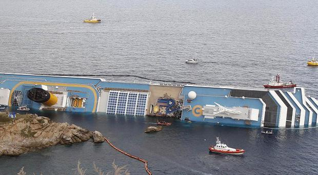 The cruise ship Costa Concordia lies on its side off the Tuscan island of Giglio, Italy (AP)
