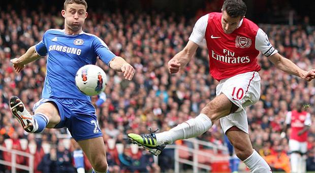 Gary Cahill (left) and Robin van Persie