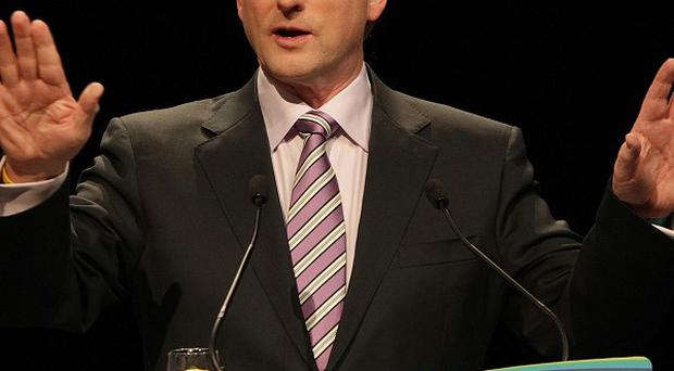 Taoiseach Enda Kenny has brushed off a poll revealing a drop in the popularity of the Government