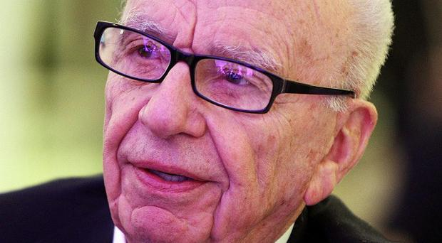 Rupert Murdoch says the UK government 'must be mad' for agreeing to contribute additional funds to the IMF