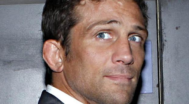 Alex Reid said he was 'gutted' to pull out of the London Marathon after spraining his ankle, pulled his hamstring and breaking his tooth
