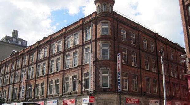 The 19th century building that houses the Athletic Stores in Queen Street