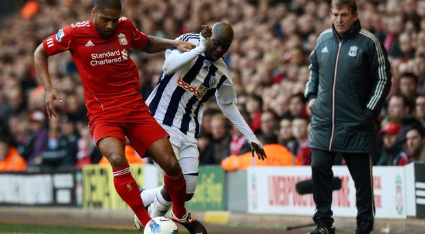 LIVERPOOL, ENGLAND - APRIL 22: Glen Johnson of Liverpool is tackled by Youssouf Mulumbu watched by Liverpool manager Kenny Dalglish during the Barclays Premier League match between Liverpool and West Bromwich Albion at Anfield on April 22, 2012 in Liverpool, England. (Photo by Gareth Copley/Getty Images)