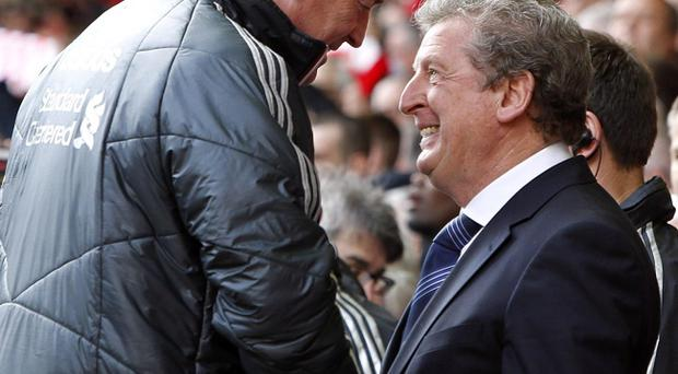 West Bromwich Albion manager Roy Hodgson (right) and Liverpool manager Kenny Dalglish shake hands before kick-off during the Barclays Premier League match at Anfield, Liverpool