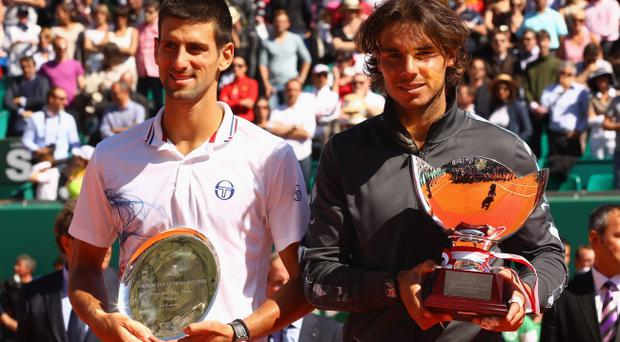 MONTE-CARLO, MONACO - APRIL 22: Rafael Nadal of Spain and Novak Djokovic of Serbia pose for a photograph after the final with their trophies during day eight of the ATP Monte Carlo Masters, at Monte-Carlo Sporting Club on April 22, 2012 in Monte-Carlo, Monaco.. (Photo by Clive Brunskill/Getty Images)