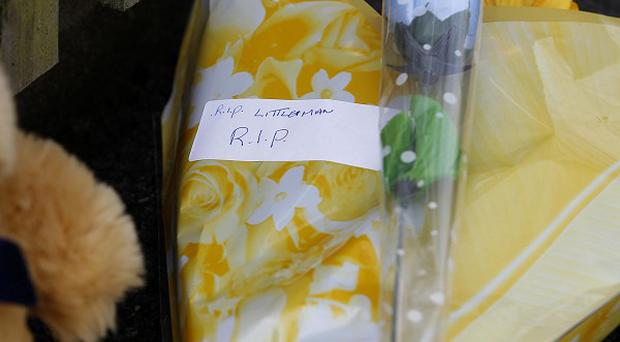 Tributes left outside a house in Bolton, Greater Manchester, following the death of a two-year-old boy