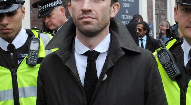 Trenton Oldfield leaves Feltham Magistrates' Court in west London, where he is charged with public order offences