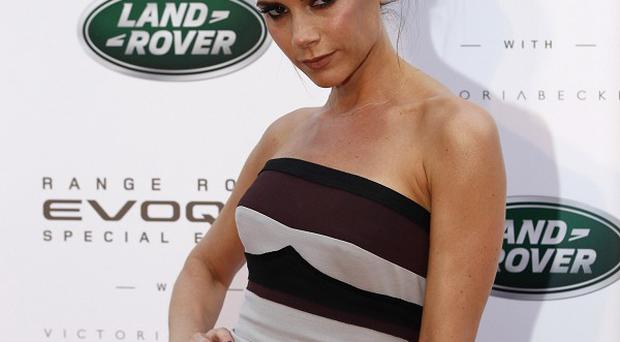 Victoria Beckham unveiled a car she has helped design during a visit to China