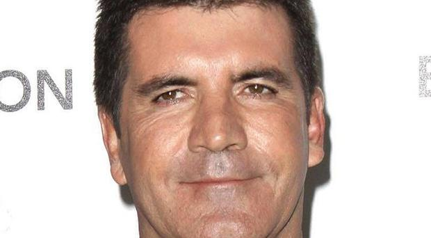 The writer of a sensational, unauthorised Simon Cowell biography has promised a sequel
