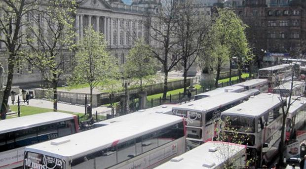 Translink Metro bus drivers abandoned their vehicles outside Belfast City Hall in protest at a colleague's suspension