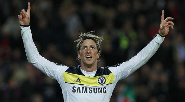 Chelsea's Fernando Torres from Spain celebrates his goal during a Champions League second leg semifinal soccer match against Barcelona at Camp Nou stadium, in Barcelona, Spain, Tuesday, April 24, 2012. (AP Photo/Andres Kudacki)