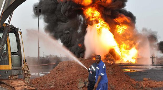 An oil rig in Heglig burns during a conflict between the two Sudans (AP)