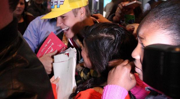 Justin Bieber was mobbed by fans at Heathrow Airport