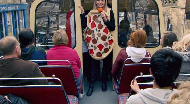 Katie Wright dresses as a slice of pizza for the latest task on The Apprentice