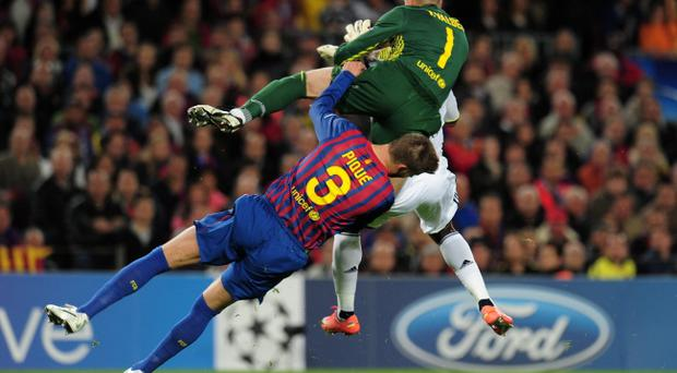 BARCELONA, SPAIN - APRIL 24: VÃctor Valdes and Gerard Pique of Barcelona clash with Didier Drogba of Chelsea during the UEFA Champions League Semi Final, second leg match between FC Barcelona and Chelsea FC at Camp Nou on April 24, 2012 in Barcelona, Spain. (Photo by Shaun Botterill/Getty Images)