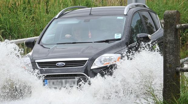 Motorists have been warned to expect flash flooding on Wednesday morning