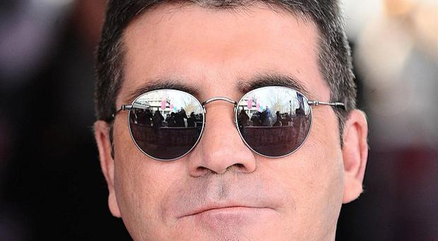 Simon Cowell attended the launch party for Tom Bower's unauthorised biography Sweet Revenge: The Intimate Life of Simon Cowell