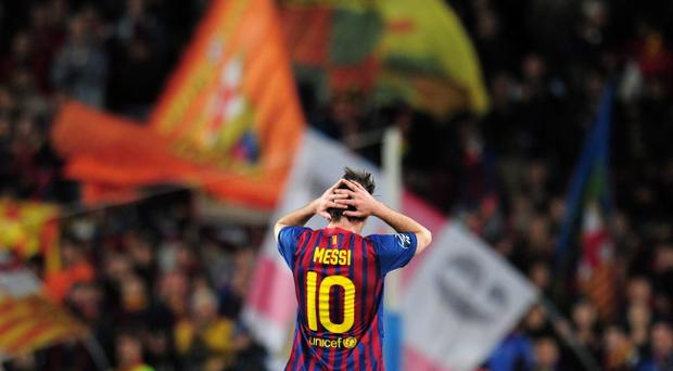 Lionel Messi shows his despair after Barcelona were knocked out of the Champions League by Chelsea on Tuesday night