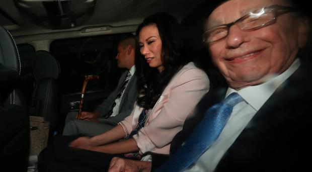 Rupert Murdoch (right) is driven to the Royal Courts of Justice this morning with his wife Wendi Deng Murdoch and son Lachlan to give evidence toi the Leveson Inquiry