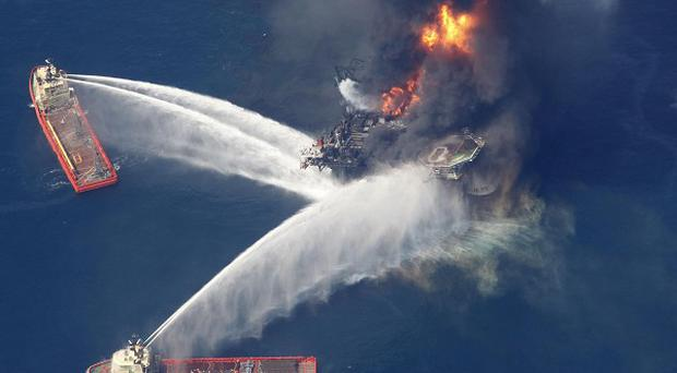 The Deepwater Horizon oil rig burns in the Gulf of Mexico (AP/Gerald Herbert)