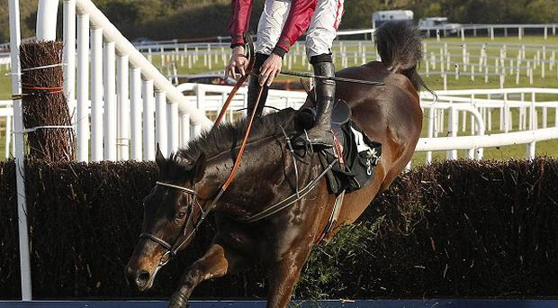 Sir Des Champs almost loses Davy Russell at the final fence