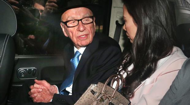LONDON, ENGLAND - APRIL 26: Rupert Murdoch (L) looks to his wife, Wendi Deng Murdoch, as they are driven from The Royal Courts of Justice after he gave evidence to The Leveson Inquiry on April 26, 2012 in London, England. This phase of the inquiry into the culture, practice and ethics of the press in the United Kingdom is looking at the owners of various media groups. The inquiry, which may take a year or more to complete, comes in the wake of the phone hacking scandal that saw the closure of The News of The World newspaper in 2011 (Photo by Peter Macdiarmid/Getty Images)