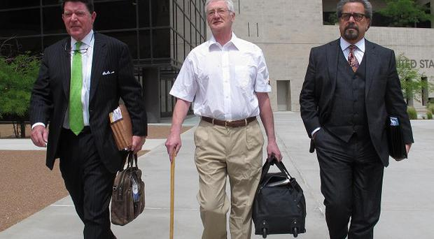 Christopher Tappin, center, leaves federal court with his lawyers in El Paso, Texas (AP)