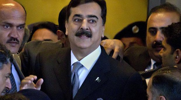 Pakistani prime minister Yousuf Raza Gilani, center,has been convicted of contempt (AP/Anjum Naveed)