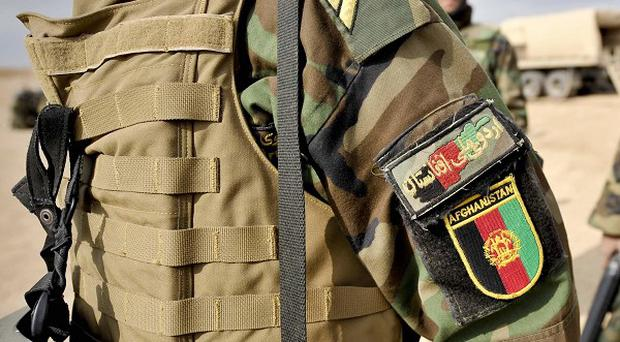 A man wearing an Afghan army uniform has killed an American serviceman
