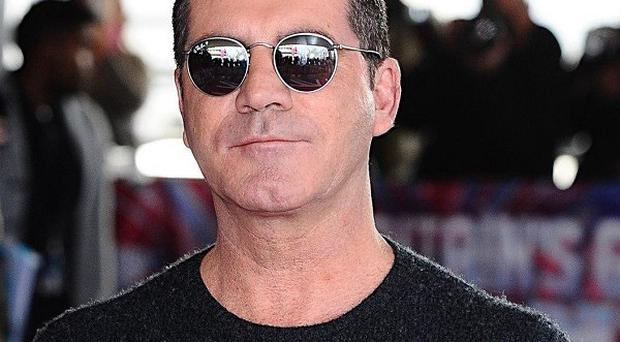Simon Cowell attended the launch party for Tom Bower's unauthorised biography on him