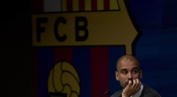 Barcelona coach Josep Guardiola pauses during a press conference after announcing his resignation