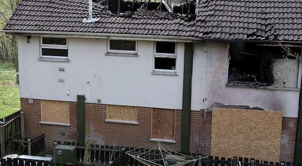 The fire-damaged flat in Dungannon where an elderly widow and her daughter died