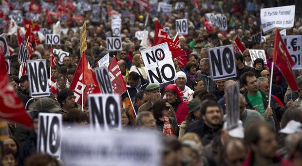 Thousands demonstrate against education and healthcare spending cuts in Madrid (AP)