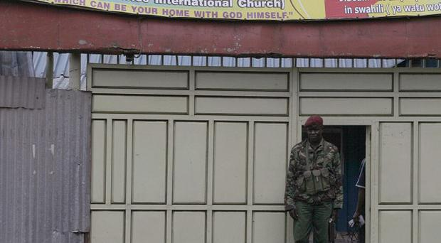 Kenyan paramilitary personnel guard the church door after a hand grenade attack on a church in downtown Nairobi (AP)