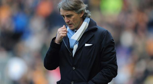 A win for Roberto Mancini's Manchester City tonight against rivals United would hand them the initiative in the race for the Premier League title