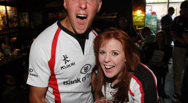 Fans at The Botanic Inn, Belfast cheer as Ulster win Saturday's Heineken Cup semi-final match against Edinburgh. Brother and sister Joeseph and Catherine McTaggart