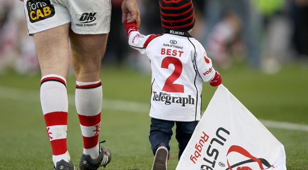 Ulster's Rory Best walks with his son after the Heineken Cup semi final match between Ulster and Edinburgh at Aviva Stadium, Dublin