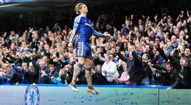 LONDON, ENGLAND - APRIL 29: Fernando Torres of Chelsea celebrates as he scores their fifth goal and completes his hat trick during the Barclays Premier League match between Chelsea and Queens Park Rangers at Stamford Bridge on April 29, 2012 in London, England. (Photo by Shaun Botterill/Getty Images)