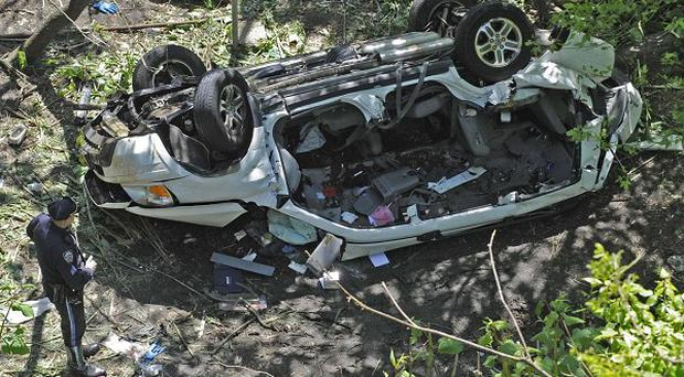 The destroyed car that plunged over the Bronx River Parkway in New York (AP/ Louis Lanzano)